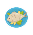 grilled fish with pieces of lemon and green leaves vector image
