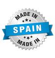 made in Spain silver badge with blue ribbon vector image vector image