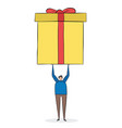 man lifts up a huge gift pack i wonder whats in vector image vector image