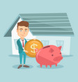 man puts money into piggy bank for buying house vector image vector image