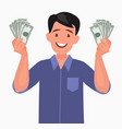 Joyful man with banknotes money in his hands