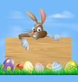 cartoon easter bunny pointing vector image vector image