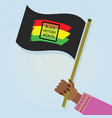 female hand holding waving black history month vector image