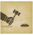 hand with auction hammer or judge gavel vector image