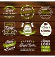 Easter labels and badges on wood background vector image