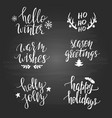 set christmas phrases on blackboard vector image