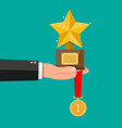trophy winner gold star cup and medal vector image vector image