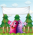 Two loving monsters under the empty banner vector image vector image