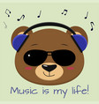 the bear is a brown musician listening to music vector image vector image
