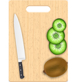 Kiwi slices and knife on the chopping board vector image vector image