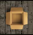 empty open cardboard box on wooden floor vector image