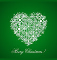 green background with a heart from snowflakes vector image vector image