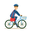Postman in blue uniform on a bicycle delivering