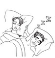 woman covering ears while man snoring in bed