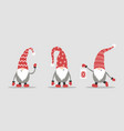 cute gnomes in red santa hats on white background vector image vector image