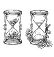 set 2 vintage sand hourglasses with flowers vector image