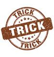 trick brown grunge round vintage rubber stamp vector image vector image