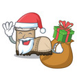 santa with gift pair working boots in shape vector image vector image