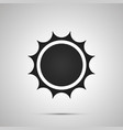 sun with spiny rays simple black icon with shadow vector image vector image
