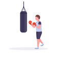 man boxer doing exercises with punching bag making vector image vector image