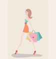 young beautiful woman with shopping bags on light vector image vector image