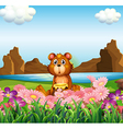 A cute bear near the flowers at the riverbank vector image vector image