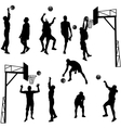 Black silhouettes of men playing basketball on a vector image vector image