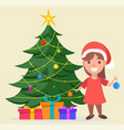 girl in santa claus hat standing near decorated vector image vector image
