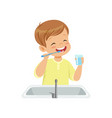boy brushing his teeth and rinsing with water kid vector image