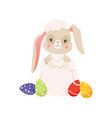 cute cartoon bunny sitting in cracked easter egg vector image vector image