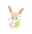 cute cartoon bunny holding green egg funny rabbit vector image vector image