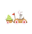 cute little bunny driving car with green egg vector image vector image