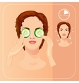 Young woman cares her face with cucumber slices vector image
