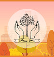 tree protected by hands as a symbol of peace day vector image