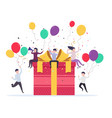 joyful people popping up near a gift box vector image