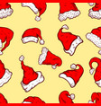 seamless pattern with santa hats and snow design vector image