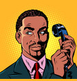 serious african man talking on a retro phone vector image vector image