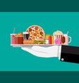 tray with fast food in hand of waiter vector image