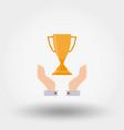 winner cup in hands vector image vector image
