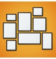 blank picture frame set on orange wall vector image