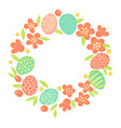 Easter wreath of flowers and painted eggs festive