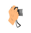 hand holding digital camera on vector image vector image