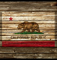 california flag painted on old wood wall vector image vector image