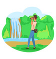 photographer taking picture waterfall vector image vector image