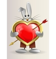 The rabbit is holding a heart with an arrow vector image