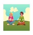 two girls siting crossed legs reading book using vector image vector image