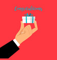 man hand holding gift box vector image vector image