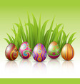 decorated easter eggs with green grass background vector image vector image