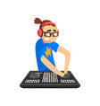 male dj in headphones playing music on mixer vector image