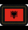flag of albania icon on black leather vector image